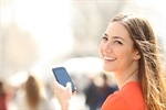 150150p302852EDNthumbsmiling-woman-with-mobile